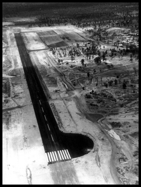 A black and white aerial shot of the completed tarmac strip.